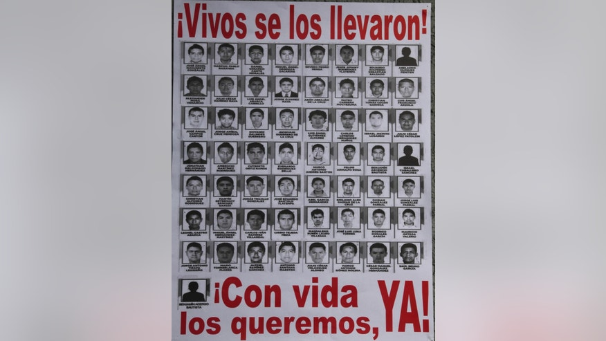 A poster seen at a demonstration at the Angel of Independence, shows images of the 43 disappeared rural college students, in Mexico City, Saturday, Nov. 8, 2014. Suspects in the disappearance of the 43 college students from  the southern state of Guerrero, have confessed to loading the youths onto dump trucks, murdering them at a landfill, then burning the bodies and dumping the ashen remains into a river, Mexican authorities said Friday. (AP Photo/Marco Ugarte)(AP Photo/Marco Ugarte)