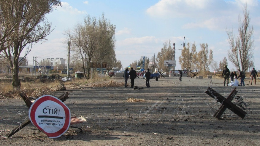 November 2, 2014 - Investigators at site  of a car explosion at a Ukraine-held checkpoint on the outskirts of Mariupol, The blast killed 2 and injured 1 Ukrainian servicemen, according to Andriy Lysenko, Ukraine's National Security spokesman. Ukraine on Friday accused Russia of sending dozens of tanks and other heavy weapons into its rebel-controlled easternmost regions.