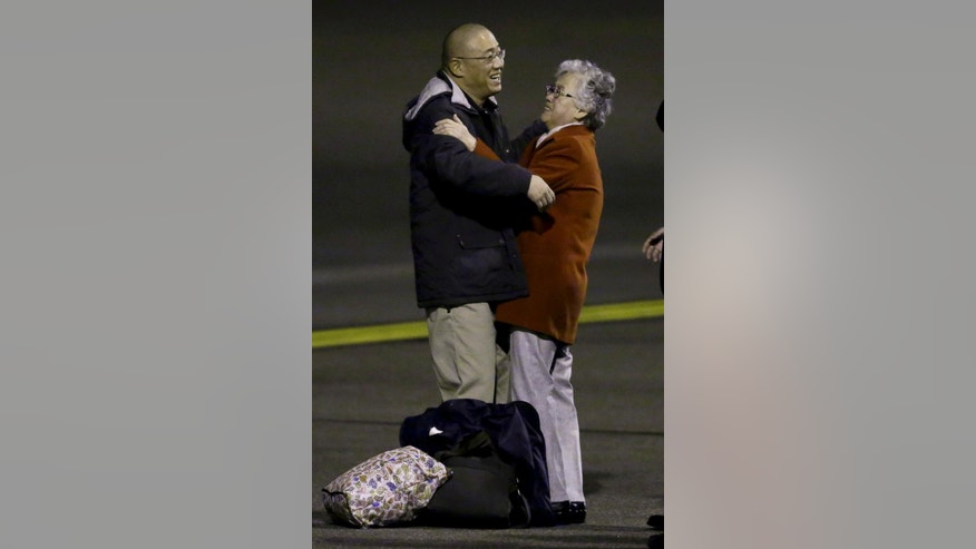 Kenneth Bae, who had been held in North Korea since 2012, greets his mother Myunghee Bae after arriving, Saturday, Nov. 8, 2014, at Joint Base Lewis-McChord, Wash., after they were freed during a top-secret mission by James Clapper, U.S. director of national intelligence. (AP Photo/Ted S. Warren)