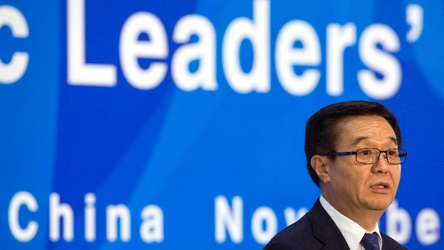 Chinese Commerce Minister Gao Hucheng speaks during a press conference on Asia-Pacific Economic Cooperation (APEC) related meetings at the China National Convention Center in Beijing, China  Saturday, Nov. 8, 2014. (AP Photo/Rolex Dela Pena, Pool)