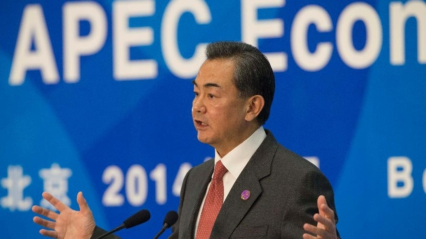 Chinese Foreign Minister Wang Yi gestures during a press conference on the Asia-Pacific Economic Cooperation (APEC) related meetings at the China National Convention Center in Beijing, China, Saturday, Nov. 8, 2014. (AP Photo/Rolex Dela Pena, Pool)