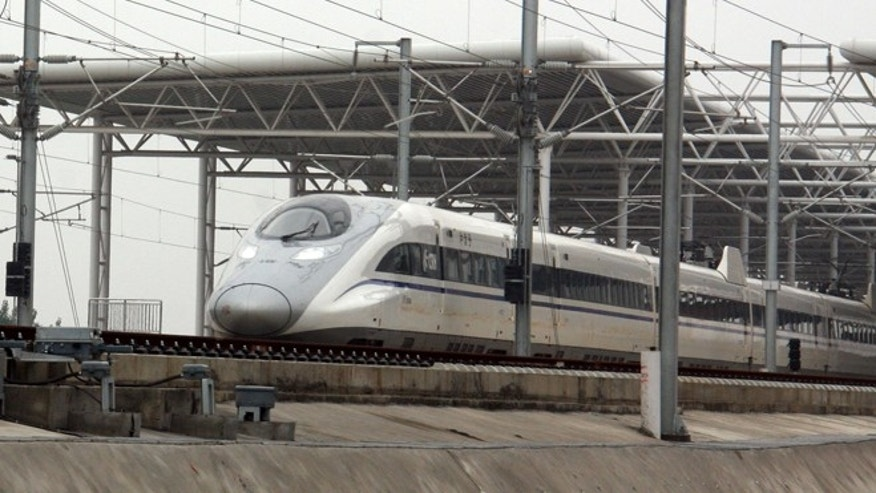 ZAOZHUANG, CHINA - MAY 11: (CHINA OUT) A CRH high-speed train runs on the Zaozhuang section of Beijing-Shanghai high-speed railway during its test run on May 11, 2011 in Zaozhuang, Shandong Province of China. After 3 years construction, from April in 2008, with total investment estimated at 220.9 billion yuan (around 32.5 billion U.S. dollars), the Beijing-Shanghai high-speed railway begins a one-month trial operation. It is expected to start operation in June this year, with the travel time between the two cities reducing to five hours from the previous 10.  (Photo by ChinaFotoPress/Getty Images)