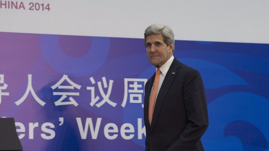 Nov. 8, 2014: U.S. Secretary of State John Kerry arrives to give a press conference at the Asia-Pacific Economic Cooperation