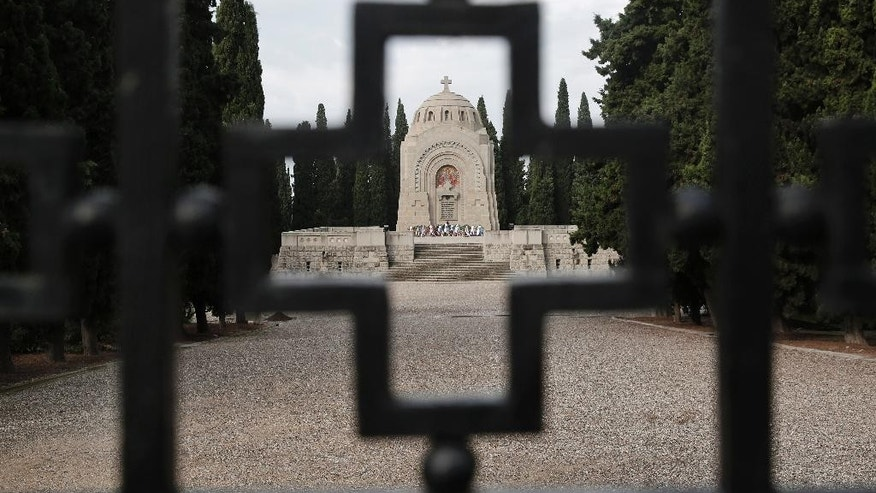 In this photo taken on Wednesday, Oct. 8, 2014, the entrance to the Zeitenlik Allied War Cemetery in Thessaloniki, Greece. Serbia, where World War I started, suffered the heaviest losses among allied nations in relation to its population, outnumbered as it fought off an Austro-Hungarian invasion for more than a year until Germany and neighbor Bulgaria joined the offensive. (AP Photo/Petros Giannakouris)