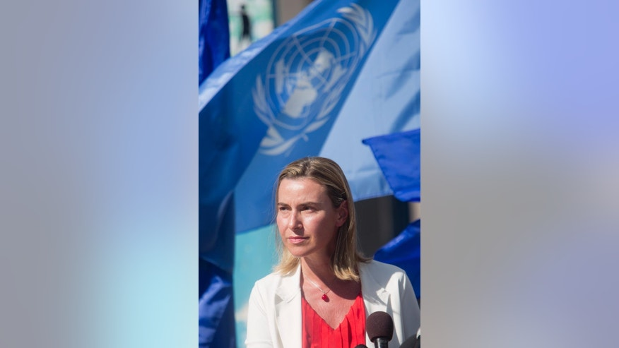 European Union foreign policy chief Federica Mogherini holds a press conference during her visit to a UN- school used as a shelter for Palestinians whose homes were destroyed during the  recent war between Israel and Hamas, in Gaza City, Saturday, Nov. 8, 2014. (AP Photo/Khalil Hamra)