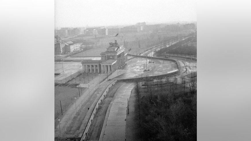 FILE - The Nov. 19, 1961 file photo shows a view from top of the old Reichstag's building to the Brandenburg Gate, which marks the border in this divided city. The semi-circled wall around the Brandenburg Gate was erected by East German police.  (AP Photo/E.Worth, file)