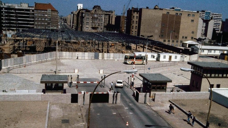 FILE - The Aug. 13, 1985 file photo shows a view into East Berlin from West Berlin at Checkpoint Charlie. The construction works on East Berlin side of checkpoint were new control barracks. (AP Photo/file)