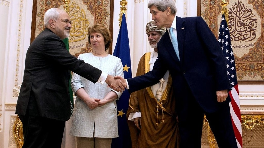 Nov. 9, 2014: U.S. Secretary of State John Kerry, right, and Iranian Foreign Minister Mohammad Javad Zarif, shake hands during a meeting in Muscat, Oman. (AP)
