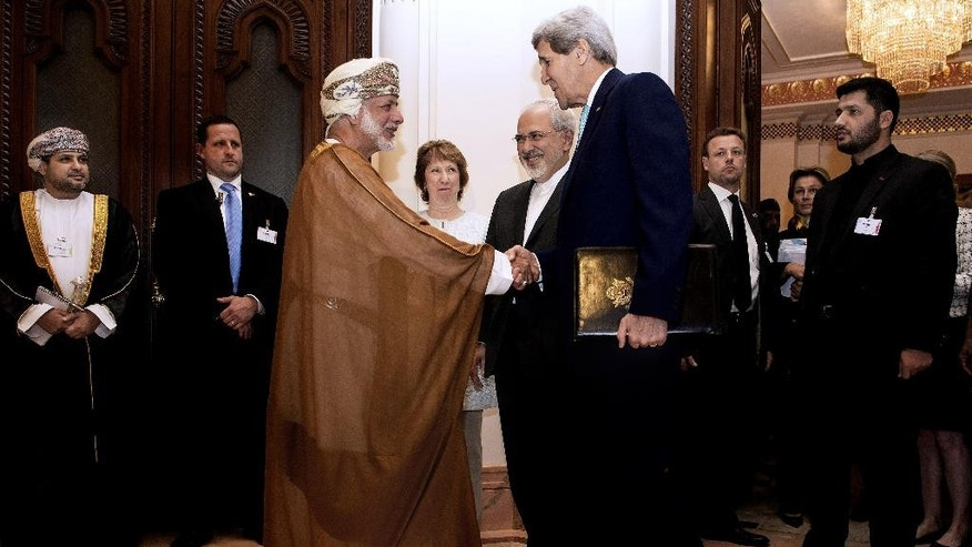 Nov. 9, 2014: U.S. Secretary of State John Kerry, right, shakes hands with Omani Foreign Minister Yussef bin Alawi bin Abdullah, ahead of a meeting in Muscat, Oman. (AP)