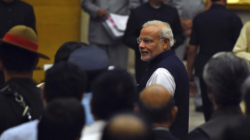 Indian Prime Minister Narendra Modi arrives for a swearing in ceremony of new ministers at the presidential palace in New Delhi, India, Sunday, Nov.9, 2014.Modi expanded his council of ministers Sunday in a bid to boost the government's agenda and kick-start the economy. (AP Photo/Prakash Singh, Pool)
