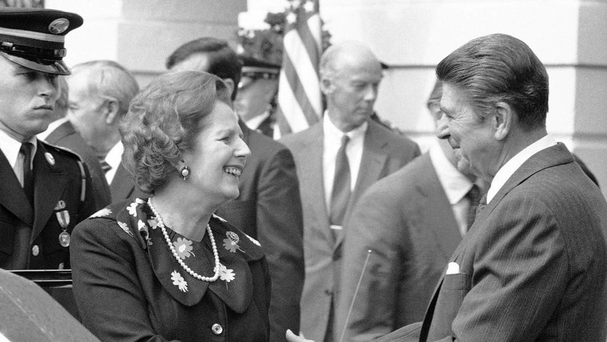 FILE- In this file photo dated Sept. 29, 1983, US President Ronald Reagan shakes hands with British Prime Minister Margaret Thatcher after their meeting, at the White House in Washington. In a secret White House tape recording made public Monday Nov. 10, 2014, Ronald Reagan apologized to Margaret Thatcher for not telling her before U.S. troops had invaded the tiny Caribbean island of Grenada in 1983, saying that total secrecy was needed because of fears that an information leak on the American side might endanger the military operation. (AP Photo/Ed Reinke, FILE)