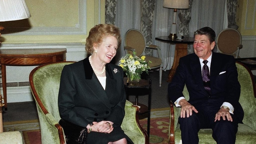FILE - In this file photo dated  Thursday, Dec. 6, 1990, Former United States President Ronald Reagan smiles with Former British Prime Minister Margaret Thatcher as the two old friends met for tea at Claridges Hotel in London.  In a secret White House tape recording made while the two held office and made public Monday Nov. 10, 2014, Ronald Reagan apologized to Margaret Thatcher for not telling her before U.S. troops had invaded the tiny Caribbean island of Grenada in 1983, saying that total secrecy was needed because of fears that an information leak on the American side might endanger the military operation. (AP Photo/Martin Cleaver, FILE)