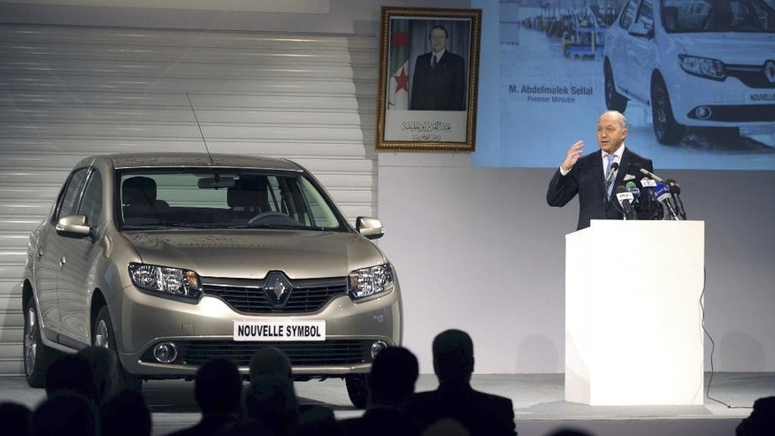 French Foreign Minister Laurent Fabius delivers a speech during the inauguration of the Renault plant in Oran, western Algeria, Monday, Nov.10, 2014. The plant is due to produce the Renault Symbol especially for the Algerian domestic market. The first new Renault car rolled off the assembly lines on Monday. (AP Photo/Sidali Djarboub)