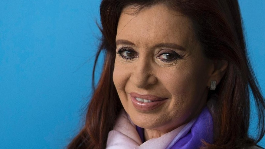 FILE - In this July 16, 2014 file photo, Argentina's President Cristina Fernandez poses for a photo during the BRICS summit at the Itamaraty Palace, in Brasilia, Brazil. Starting Monday, Nov. 10, 2014, doctors have ordered Fernandez 10 days rest after being hospitalized one week for a colon infection. (AP Photo/Felipe Dana, File)
