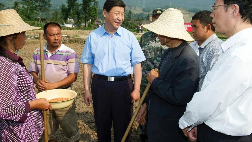 May 21, 2013 - FILE photo of Chinese President Xi Jinping, center, taling with villagers at a corn field in Qinglongchang Village of Lushan County, southwest China's Sichuan Province after a strong earthquake hit the county on April 20, 2013. As he hosts President Obama and other world leaders, China's president appears firmly in charge of a vast but stable communist state boasting the world's 2nd-largest economy.