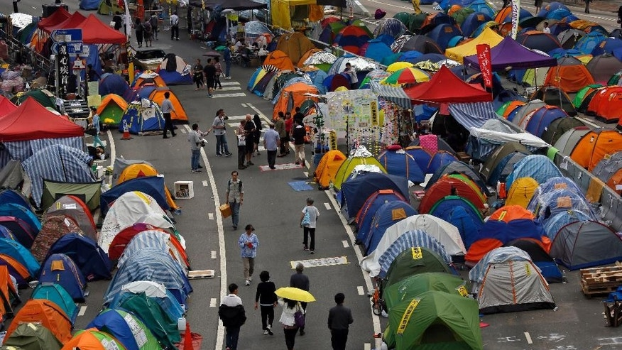 Tents set up by pro-democracy protesters are seen in an occupied area outside government headquarters in Hong Kong's Admiralty district in Hong Kong Tuesday, Nov. 11, 2014. Pro-democracy protesters camped out on main streets in Hong Kong for more than six weeks face arrest after a court authorized police to help bailiffs clear them from occupation sites, a senior government official warned Tuesday. (AP Photo/Vincent Yu)