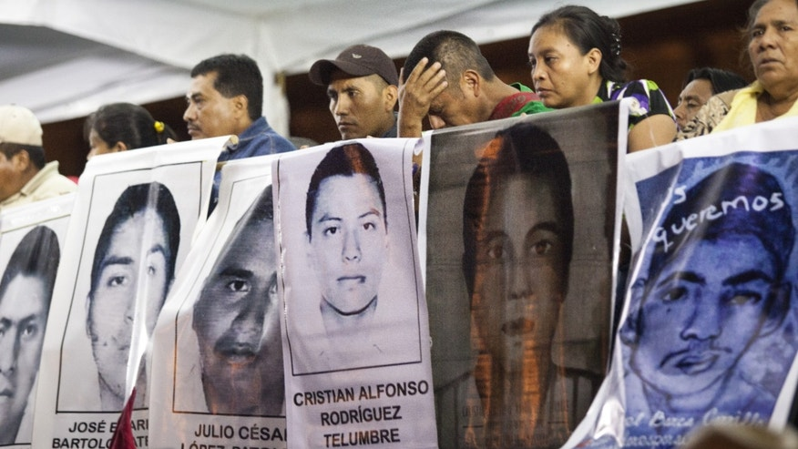 Families of 43 missing students protest the government and demand answers on November 5, 2014 in Mexico City.