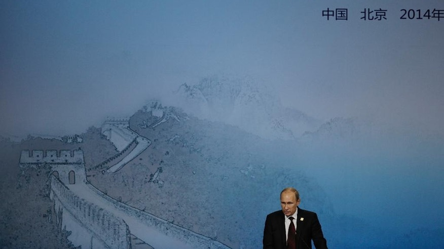 "Russian President Vladimir Putin delivers a speech for the APEC CEO Summit, ""What does the Asia Pacific mean to Russia"" as part of the Asia-Pacific Economic Cooperation (APEC) Summit at the China National Convention Center in Beijing, Monday, Nov. 10, 2014. (AP Photo/Andy Wong)"