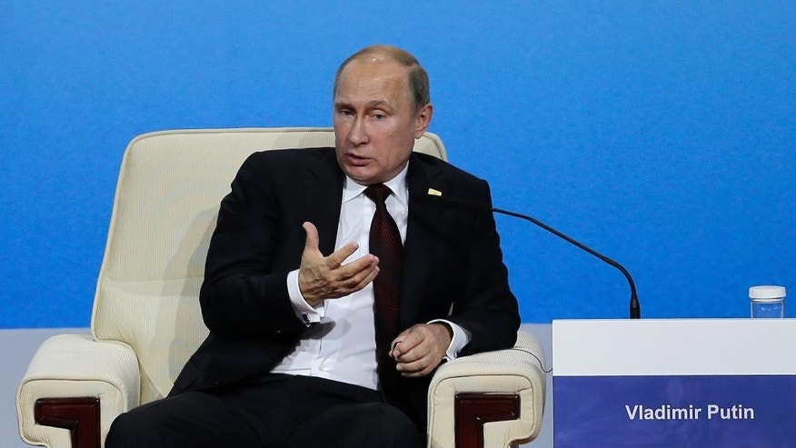 Russian President Vladimir Putin speaks at the APEC CEO Summit at the China National Convention Center in Beijing, Monday, Nov. 10, 2014. (AP Photo/Andy Wong)