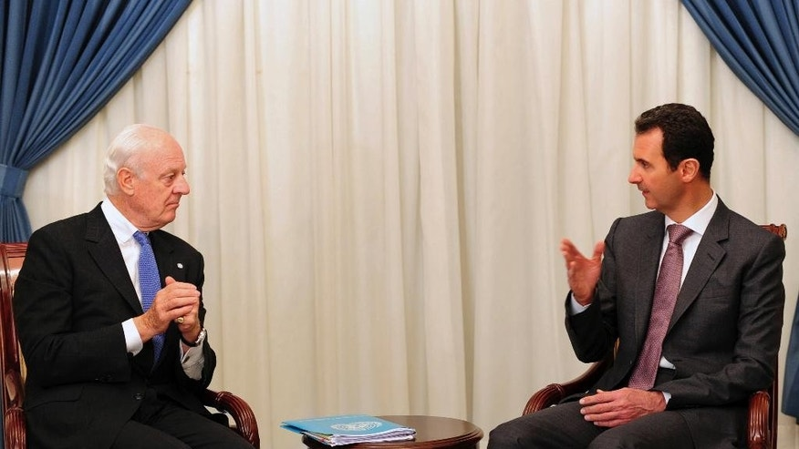 "In this photo released by the Syrian official news agency SANA, Syrian President Bashar Assad, right, speaks with United Nations special envoy to Syria Staffan de Mistura in Damascus, Syria, Monday, Nov. 10, 2014. Assad said a cease-fire proposal for the embattled northern city of Aleppo, which was raised by de Mistura, was ""worth studying,"" in remarks made to state-run media Monday. (AP Photo/SANA)"