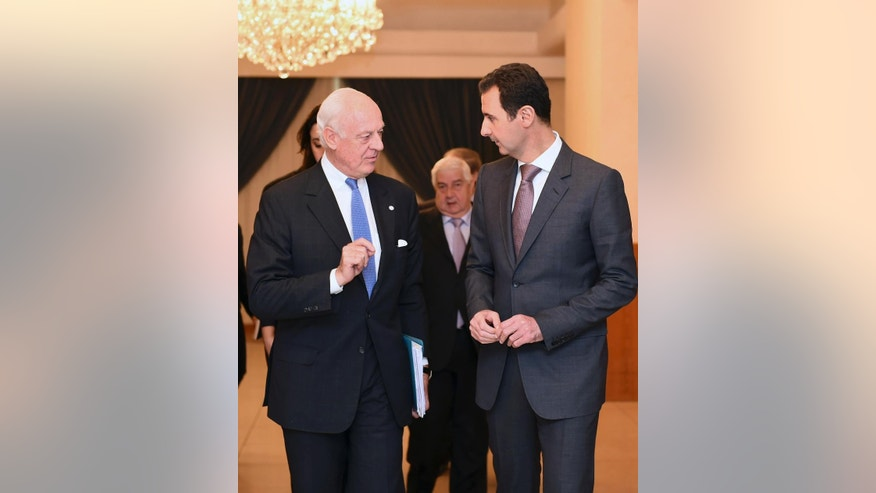"In this photo released by the Syrian official news agency SANA, United Nations special envoy to Syria Staffan de Mistura, left, speaks with Syrian President Bashar Assad in Damascus, Syria, Monday, Nov. 10, 2014. Assad said a cease-fire proposal for the embattled northern city of Aleppo, which was raised by de Mistura, was ""worth studying,"" in remarks made to state-run media Monday. (AP Photo/SANA)"