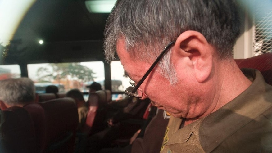 Lee Joon-seok, the captain of the sunken South Korean ferry Sewol, on the bus, arrives for verdict and sentence session at Gwangju District Court in Gwangju, South Korea, Tuesday, Nov. 11, 2014. South Korean prosecutors on Monday, Oct. 27, 2014,  demanded the death penalty for the captain of the ferry that sank in April, killing more than 300 people, and life sentences to three key crew members, a court official said. (AP Photo/Yonhap, Hyung Min-woo) KOREA OUT