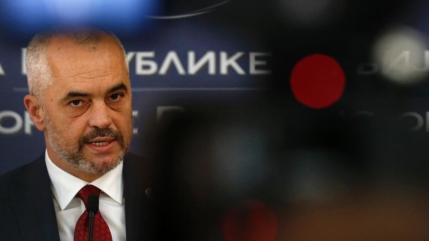 2Albanian Prime Minister Edi Rama speaks during a news conference after talks with his Serbian counterpart Aleksandar Vucic in Belgrade, Serbia, Monday, Nov. 10, 2014. Rama arrived on a two-day official visit to Serbia the first by an Albanian leader in 68 years. (AP Photo/Darko Vojinovic)