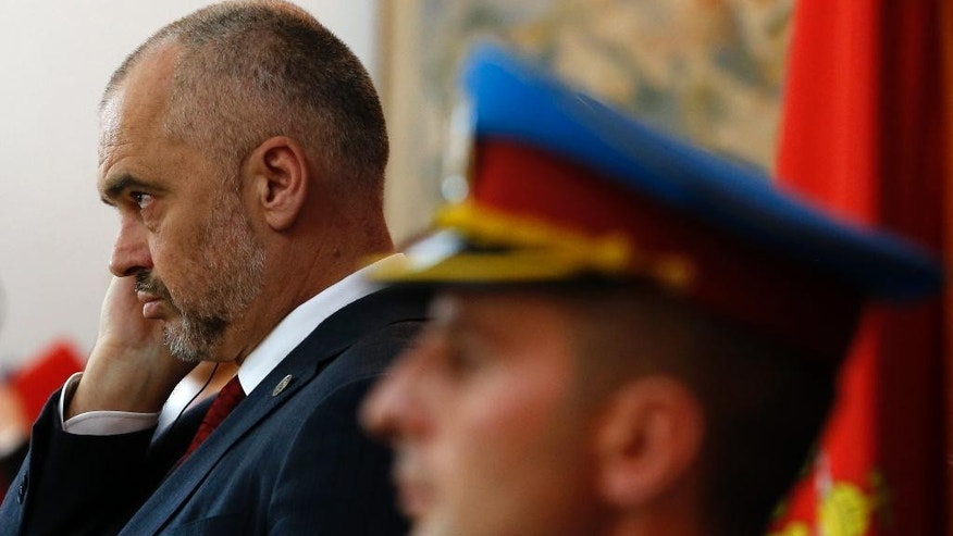 Albanian Prime Minister Edi Rama listens as his Serbian counterpart Aleksandar Vucic, during a welcoming ceremony in Belgrade, Serbia, Monday, Nov. 10, 2014. Rama arrived on a two-day official visit to Serbia the first by an Albanian leader in 68 years. (AP Photo/Darko Vojinovic)