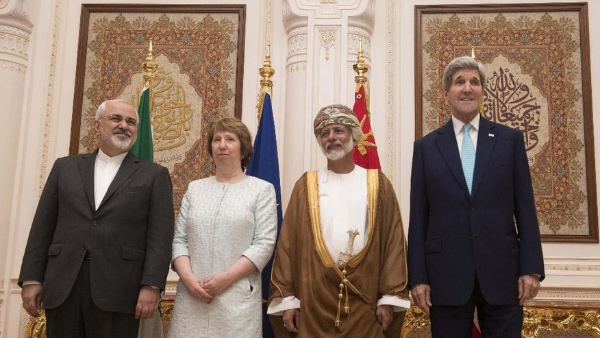 Posing for a photo are, from left, Iranian Foreign Minister Javad Zarif,  European Union adviser Catherine Ashton, Omani Minister Responsible for Foreign Affairs Yussef bin Alawi and US Secretary of State John Kerry,  in Muscat on Sunday Nov. 9, 2014.  Talks are underway in high-level negotiations to limit Iran's nuclear program in exchange for easing crippling sanctions on the Islamic republic's economy. (AP PHOTO/NICHOLAS KAMM, POOL)