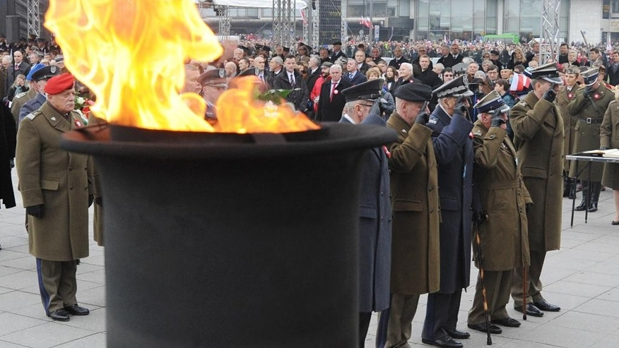 Polish army officers and veterans salute during celebrations marking the 96th anniversary of  Poland's independence in Warsaw, Poland, Tuesday, Nov. 11, 2014. (AP Photo/Alik Keplicz)
