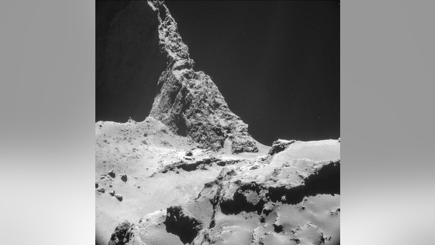 The picture taken with the navigation camera on Rosetta and released by the European Space Agency ESA shows the boulder-strewn neck region of Comet 67P/Churyumov–Gerasimenko, with the smaller lobe on the left and the larger lobe on the right. It was captured from a distance of 9.7 km from the center of the comet (about 7.7 km / 4.8 miles) from the surface)  on Oct. 28, 2014. On Wednesday, Nov. 12,  2014 the Philae lander will be detached from Rosetta to land on the comet. (AP Photo/ESA)