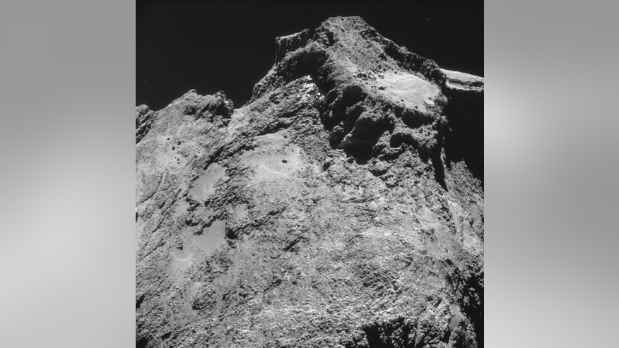 The picture taken with the navigation camera on Rosetta and released by the European Space Agency ESA shows a raised plateau on the larger lobe of Comet 67P/Churyumov–Gerasimenko. It was captured from a distance of 9.8 km from the center of the comet (7.8 km / 4.8 miles from the surface) Oct. 24,  2014. On Wednesday, Nov. 12,  2014 the Philae lander will be detached from Rosetta to land on the comet. (AP Photo/ESA)