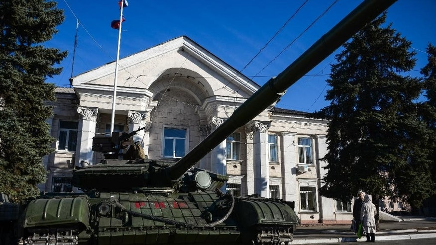 In this Wednesday Nov. 5, 2014 photo, a tank is parked in Perevalsk, Eastern Ukraine. Perevalsk and Alchevsk both participated in a contentious vote in early November to elect separatist deputies and leaders, but it is evident the outcome of the poll means little on the ground. (AP Photo/Mstyslav Chernov)