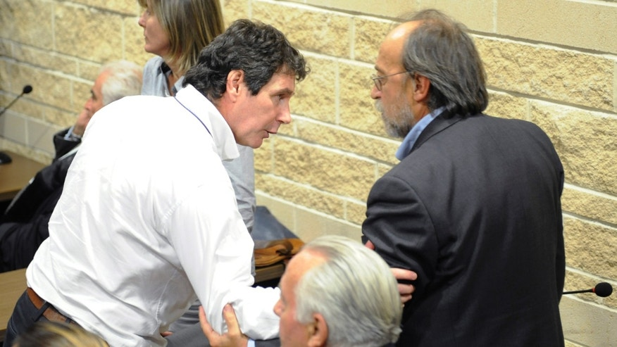 Nov. 10, 2014: Giulio Lorenzo Selvaggi, left, director of National Earthquake Centre and Bernardo De Bernardinis, former vice-president of Civil Protection Agency's technical department talk after after the reading of the appeals sentence in L'Aquila,