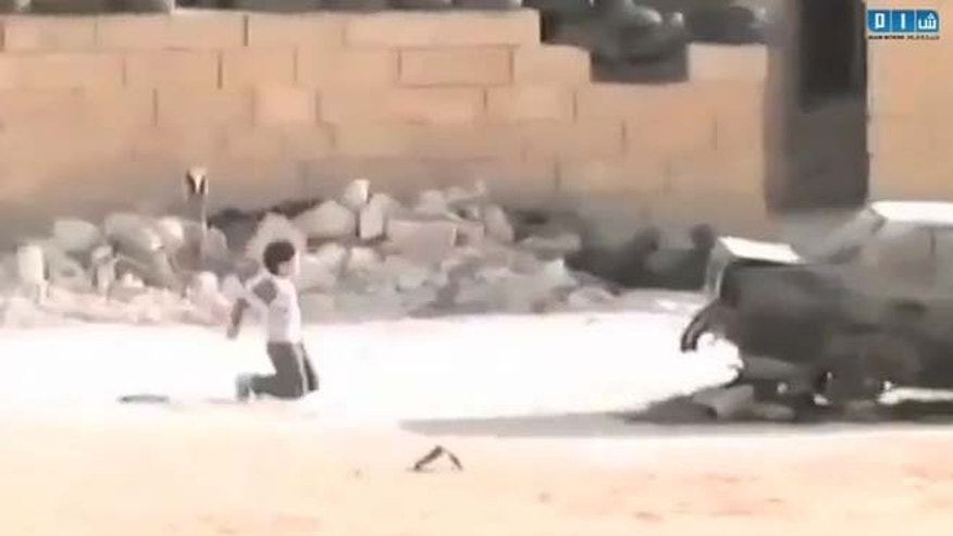 The video purportedly shows a Syrian boy faking his death to rescue a girl.
