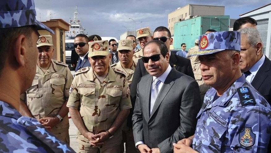 FILE - In this Tuesday, Oct. 21, 2014 photo provided by Egypt's state news agency MENA, Egyptian President Abdel-Fattah el-Sissi attends Naval exercises in Alexandria. Egypt is gearing up for parliamentary elections, the second since the 2011 uprising. But with the once-triumphant Muslim Brotherhood now banned from public life and a new military-backed government suppressing public expression, analysts and activists say the next legislature is unlikely to check the extensive powers enjoyed by the president. (AP Photo/MENA, Fady Fars, File)