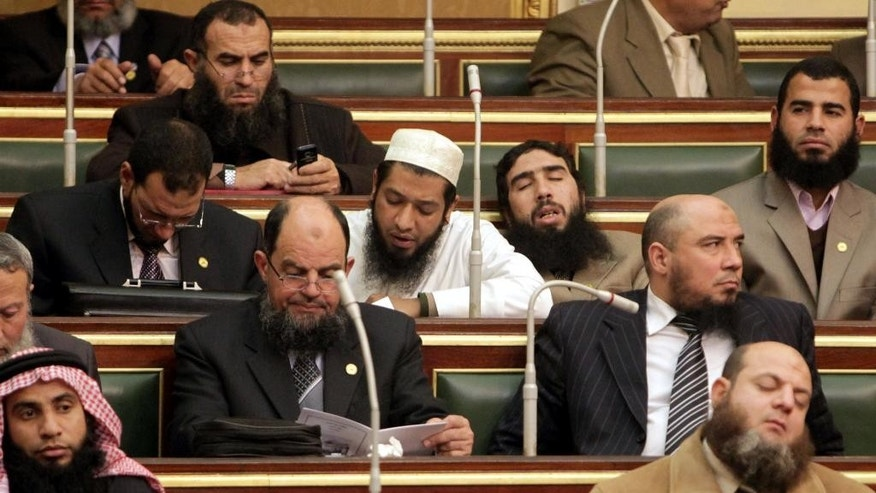 FILE - In this Monday, Jan. 23, 2012 file photo, Salafi lawmakers attend the first Egyptian parliament session after the revolution that ousted former President Hosni Mubarak, in Cairo. Egypt is gearing up for parliamentary elections, the second since the 2011 uprising. But with the once-triumphant Muslim Brotherhood now banned from public life and a new military-backed government suppressing public expression, analysts and activists say the next legislature is unlikely to check the extensive powers enjoyed by President Abdel-Fattah el-Sissi. (AP Photo/Asmaa Waguih,Pool, File)