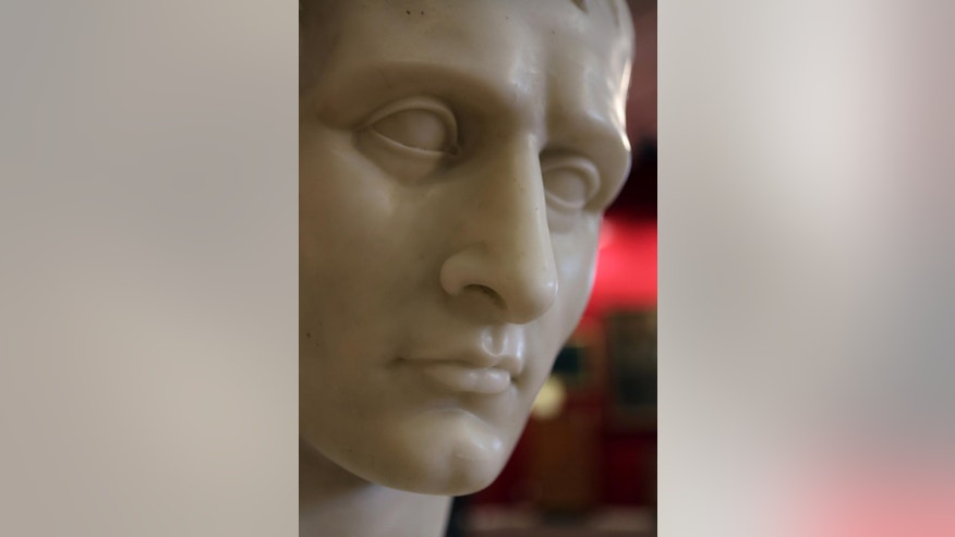 A white marble bust of Napoleon Bonaparte, from the Napoleonic collection of the Palais de Monaco,is presented in Fontainebleau, south of Paris, France, Wednesday Nov. 12, 2014. The bust is part of the Napoleonic collection gathered by Prince Louis II, that will be put on sale Nov. 15 and Nov. 16 in Fontainbleau. More than 1,000 objects among them Napoleon's famous hat, will be put on sale at this auction. (AP Photo/Remy de la Mauviniere)