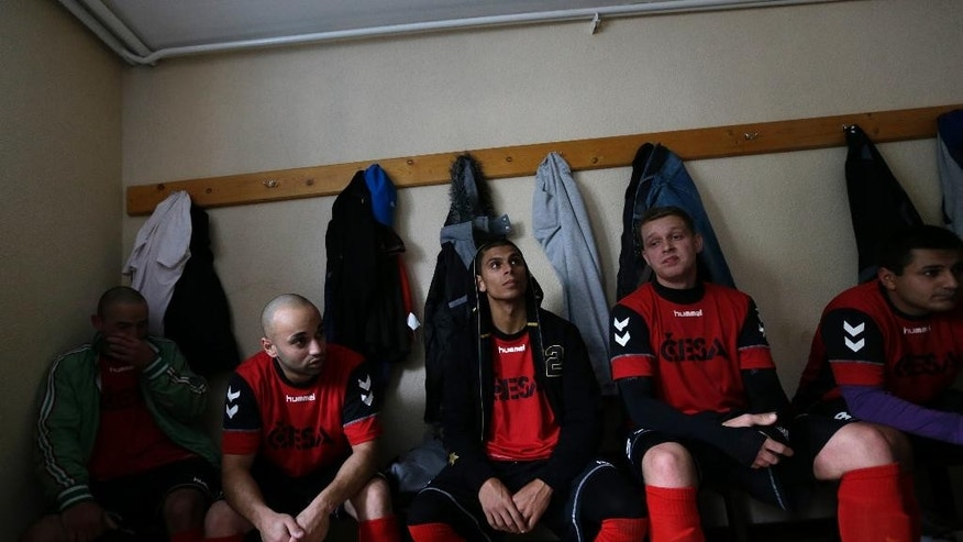 Players of Roma Decin  sit in a dressing room during a halftime break of their match in Decin, Czech Republic, Sunday, Nov. 2, 2014.   The Roma Decin football club is having its best season ever, winning six of 10 matches and climbing to fourth in the standings. But the team's mainly Gypsy players have found little to celebrate: They keep winning because their opponents don't turn up.  (AP Photo/Petr David Josek)