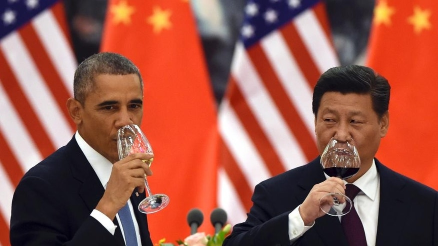 Nov. 12, 2014: U.S. President Barack Obama, left, and Chinese President Xi Jinping drink a toast at a lunch banquet in the Great Hall of the People in Beijing