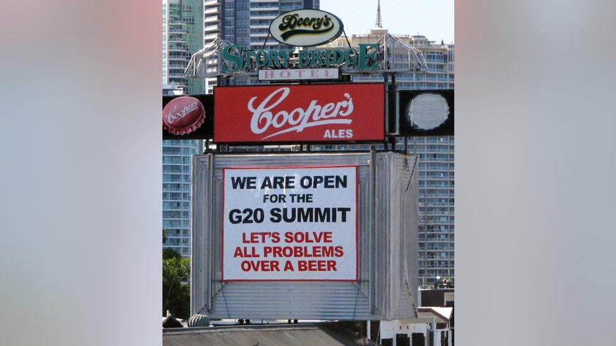 In this Nov. 8, 2014 photo,  a sign is displayed on the Story Bridge Hotel near the venue where the G20 leaders' summit will take place in Brisbane, Australia. For the boosters of Queensland state, playing host to top officials from the 20 biggest industrialized and developing economies is a long overdue acknowledgement they don't live in subtropical backwater. Small businesses, however, are struggling against the disruptions of road closures and an over-the-top security response. (AP Photo/Rod McGuirk)
