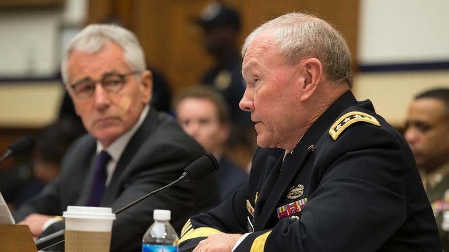 Joint Chiefs Chairman Gen. Martin Dempsey, right, accompanied by Defense Secretary Chuck Hagel, testifies on Capitol Hill in Washington, Thursday, Nov. 13, 2014, before the House Armed Services committee hearing on the Islamic State Group.  (AP Photo/Evan Vucci)