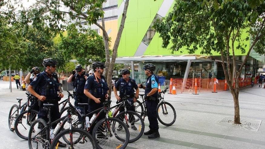 In this Thursday, Nov. 13 2014 photo police on bikes rest after patrolling the streets in the central business district ahead of the G-20 summit in Brisbane, Australia. Ahead of the summit, the government passed a special security act temporarily giving police more power to search members of the public - including permission to strip search anyone they believe is carrying a weapon or any other prohibited item. (AP Photo/Mark Baker)