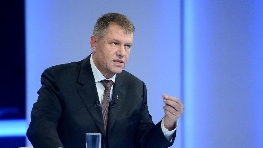 Klaus Iohannis leader of Romania's centre-right Liberals and mayor of the Transylvanian city of Sibiu, gestures during a televised debate with Prime Minister and candidate of the ruling Social Democracy Party (PSD), Victor Ponta, that took place in Bucharest, Romania, Tuesday, Nov. 11, 2014. An election runoff will be held on Nov. 16., to elect a new leader as President Traian Basescu steps down after 10 years in office. (AP Photo/Octav Ganea, Mediafax) ROMANIA OUT