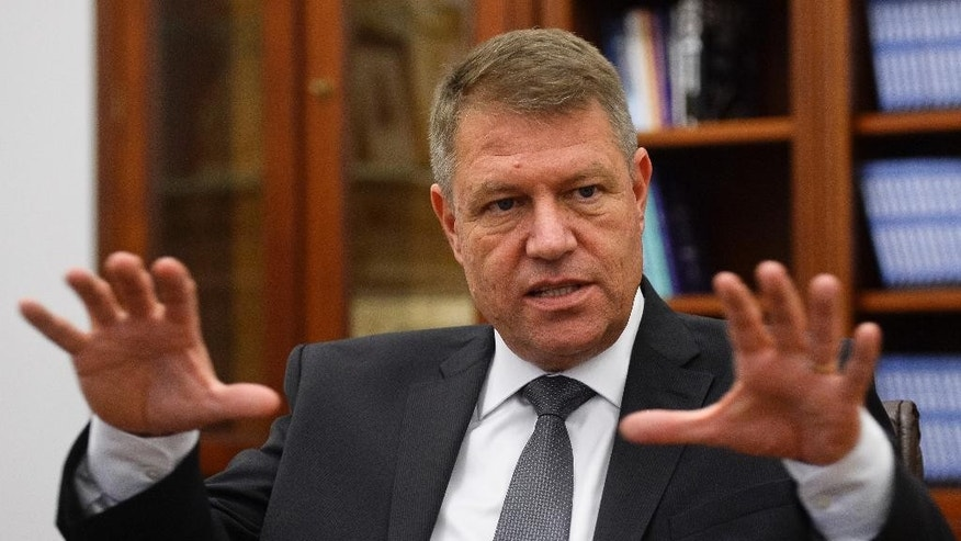 Klaus Iohannis, leader of Romania's center-right Liberals and mayor of the Transylvanian city of Sibiu, gestures during an interview with The Associated Press in Bucharest, Romania, Thursday, Nov. 13, 2014. Iohannis says Romania made important progress in the past 10 years in the fight against corruption and the independence of the justice system, but needs to change the style of the political debate. The ethnic German mayor is running against Prime Minister Victor Ponta in the Presidential Election runoff, on Nov. 16. Ponta, a former prosecutor, led Iohannis by 10 points in the first-round voting on Nov. 2, and polls indicate Ponta is likely to win, despite corruption probes and convictions of some of Ponta's senior aides. (AP Photo/Octav Ganea, Mediafax) ROMANIA OUT