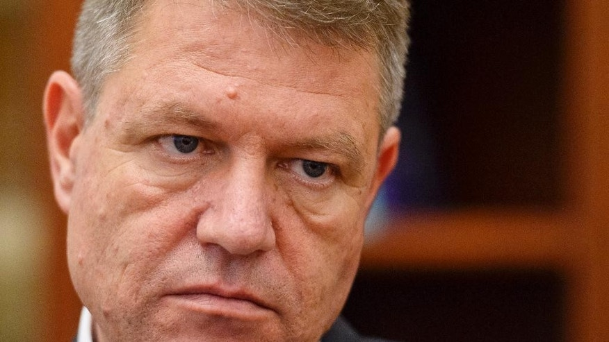 Klaus Iohannis, leader of Romania's center-right Liberals and mayor of the Transylvanian city of Sibiu, listens to a question during an interview with The Associated Press in Bucharest, Romania, Thursday, Nov. 13, 2014. Iohannis says Romania made important progress in the past 10 years in the fight against corruption and the independence of the justice system, but needs to change the style of the political debate. The ethnic German mayor is running against Prime Minister Victor Ponta in the Presidential Election runoff, on Nov. 16. Ponta, a former prosecutor, led Iohannis by 10 points in the first-round voting on Nov. 2, and polls indicate Ponta is likely to win, despite corruption probes and convictions of some of Ponta's senior aides. (AP Photo/Octav Ganea, Mediafax) ROMANIA OUT