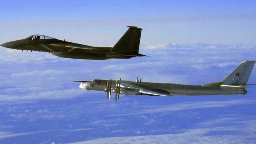 "Sept. 28, 2006: This file photo provided by the U.S. Air Force shows an F-15C Eagle from the 12th Fighter Squadron at Elmendorf Air Force Base in Anchorage, Alaska, flying next to a Russian Tu-95 ""Bear"" bomber, right, during a Russian exercise which brought the bomber near the west coast of Alaska. Russias defense minister says the military will conduct regular long-range bomber patrols, ranging from the Arctic Ocean to the Caribbean and the Gulf of Mexico."