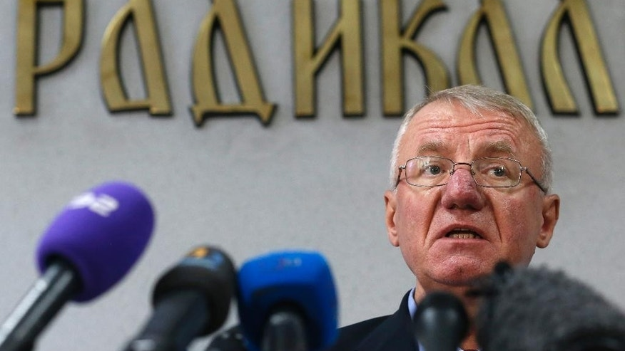 Serbian far-right leader Vojislav Seselj speaks during a press conference in Belgrade, Serbia, Thursday, Nov. 13, 2014. Judges at the U.N. war crimes tribunal released Seselj, accused of recruiting notorious paramilitary forces during the bloody Balkan wars, to arrive home to a boisterous welcome Wednesday after his provisional release due to ill health. (AP Photo/Darko Vojinovic)