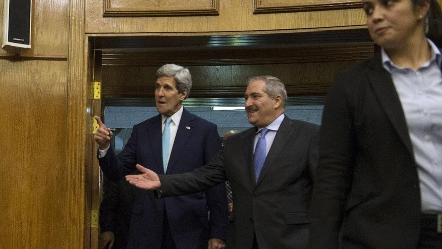 US Secretary of State John Kerry, left, and Jordanian Foreign Minister Nasser Judeh, center, arrive to give a press conference in Amman on Thursday, Nov. 13, 2014, to discuss the upsurge in violence in east Jerusalem and the West Bank following talks between Kerry, King Abdullah II of Jordan and Israeli Prime Minister Benjamin Netanyahu.  US Secretary of State John Kerry said that steps were agreed at talks in Amman to lower tensions between the Israelis and Palestinians. (AP Photo/Nicholas Kamm, Pool)