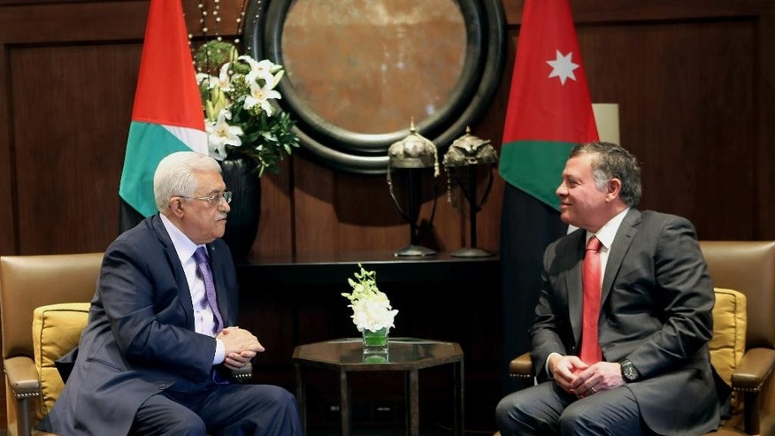 Jordanian King Abdullah II, right, meets with Palestinian President Mahmoud Abbas in Amman, Jordan, Wednesday, Nov. 12, 2014. Abbas' adviser Nabil Abu Rdeneh said Abbas was also scheduled to meet U.S. Secretary of State John Kerry in the Jordanian capital on Thursday, and would emphasize his concerns about alleged Israeli attempts to change the status quo at the Jerusalem holy site, known to Jews as the Temple Mount and to Muslims as the Noble Sanctuary. (AP Photo/Raad Adayleh)